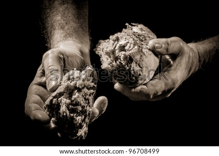 The sharing of bread as a concept of helping the poor - stock photo