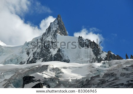 The sharp needle of the Mont Mallet and its glacier in the french alps above Chamonix.