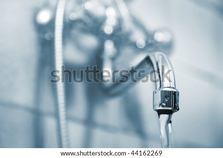 The shiny water faucet in a bathroom - stock photo