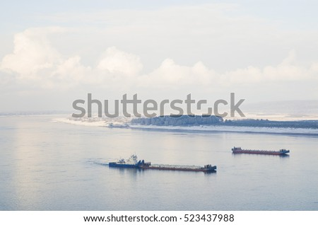 The ship with barge on the Yenisei river