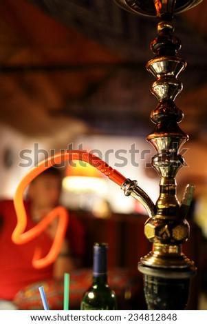 The shisha on the plate in an arabic restaurant - stock photo