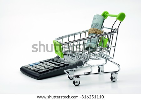 the shopping cart with calculator and money isolated on white background - stock photo