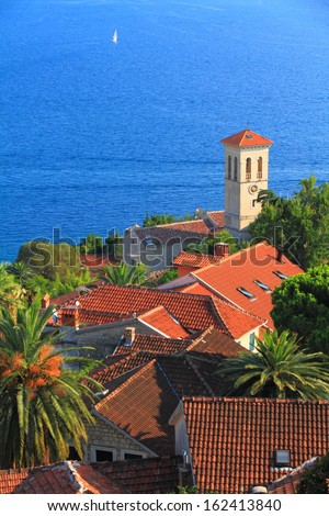 The shores of Mediterranean sea and a town with venetian architecture - stock photo