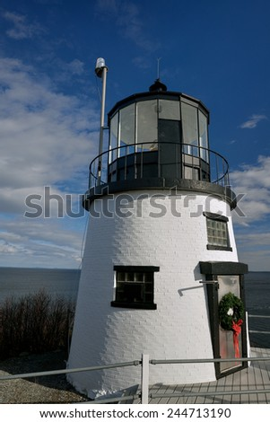 The short and squat Owls Head Lighthouse at the West side of Penobscot Bay