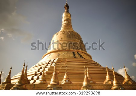 The Shwemawdaw Pagoda was built around 1000 years ago and located in Bago, Myanmar.  - stock photo