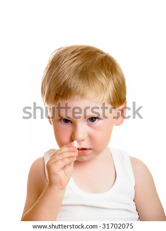 The sick little boy digs in drops in a nose
