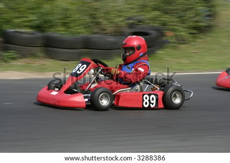 The side view of a red go kart - stock photo
