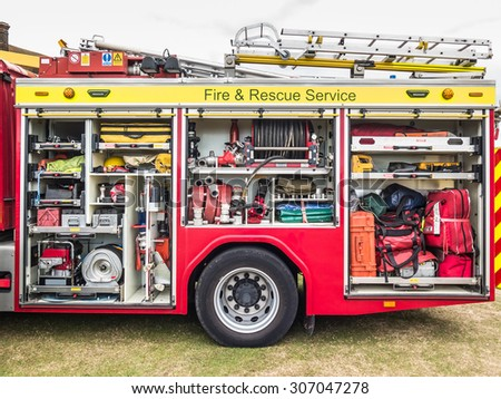The side view of equipment packed neatly inside a fire engine, fire truck.