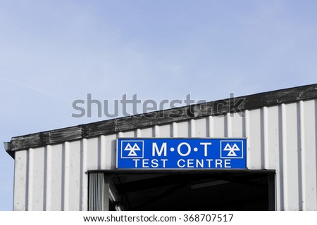 The sign for an MOT vehicle test centre in the UK