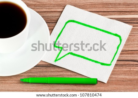 The sign of talk on a napkin and cup of coffee - stock photo