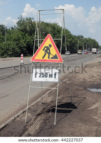 "The sign "" Road works "" on a portable frame of the armature"