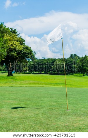 The signal flag on the golf course