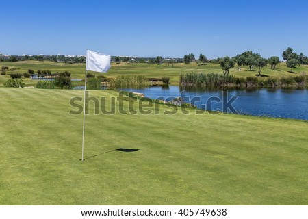 The signal flag on the golf course. Lake in the background.
