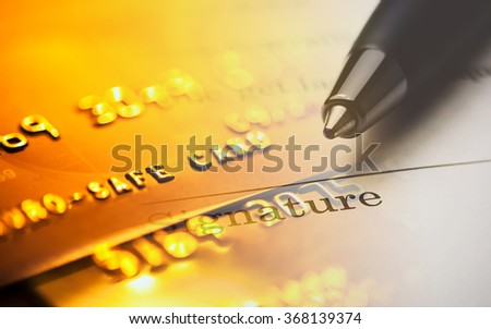 The signature and credit card. Macro image. - stock photo