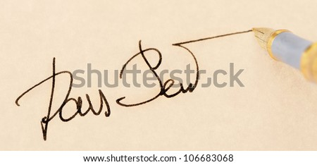 The signature close up and fountain pen.Old yellow paper. Selective focus - stock photo