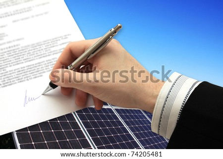 The Signature of Business Contract in front of the Solar Power Station