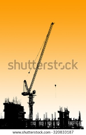 The silhouette construction site with tower crane background