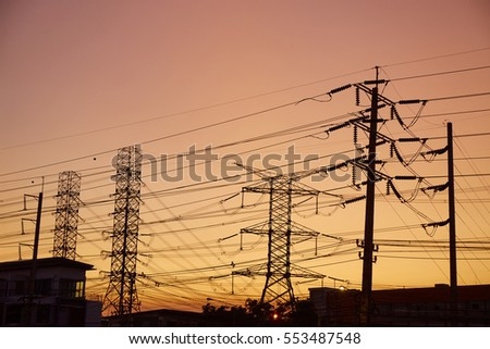 The silhouette of electric poles