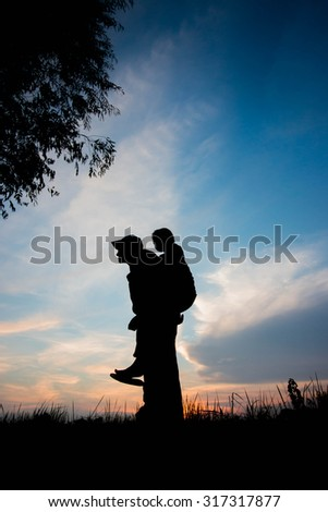the Silhouette of father and his son
