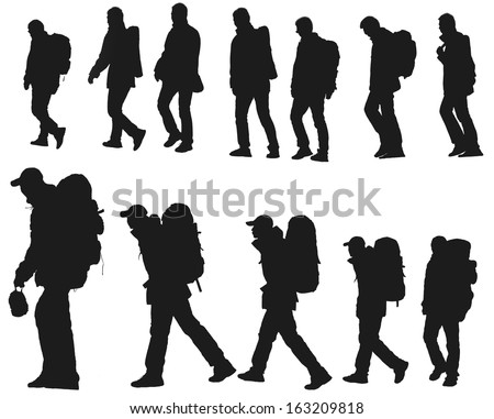 The silhouette of hikers isolated on a white background - stock photo
