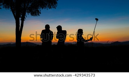The silhouette people standing.Silhouette view on sunrise.Silhouette woman and men.