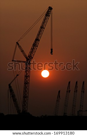 The Silhouette Picture of Crane in sunsets.
