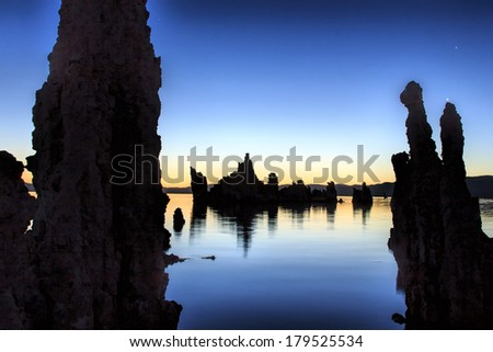 The silhouettes of the tufas at Mono Lake, California just before sunrise. - stock photo