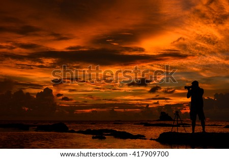 The sillhouette of photographer taking photo on sunrise