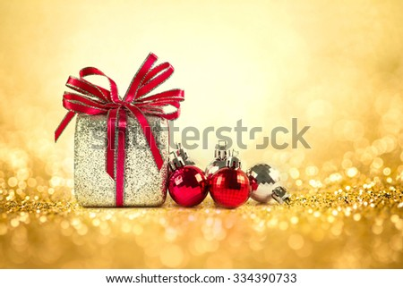 The Silver and red Christmas balls and gifts on sweet gold glitter lighting  background