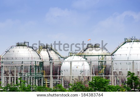 The silver and white huge storage natural gas tanks - stock photo