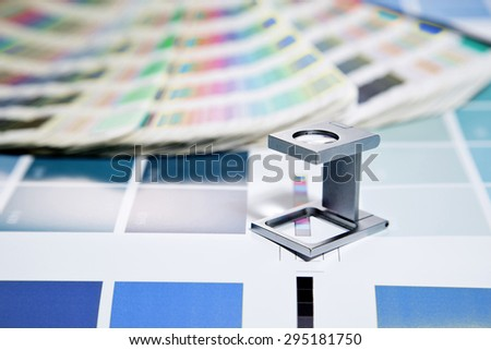 The silver glass standing on a leaf of the test print and pantone - stock photo