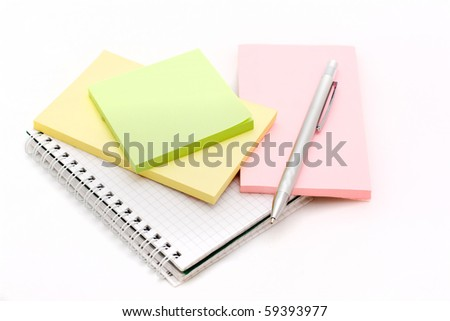 The silver pen lying on a notebook on a white background - stock photo