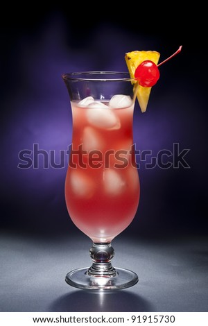 The Singapore Sling is both a cocktail that was invented by Ngiam Tong Boon for the Raffles Hotel in Singapore sometime between 1910 and 1915 and a movie directed and written by Nikos Nikolaidis. - stock photo