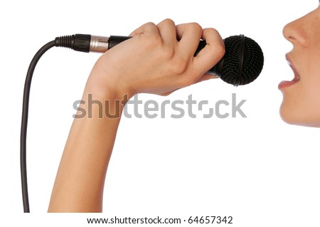 The singer sings a song in a microphone