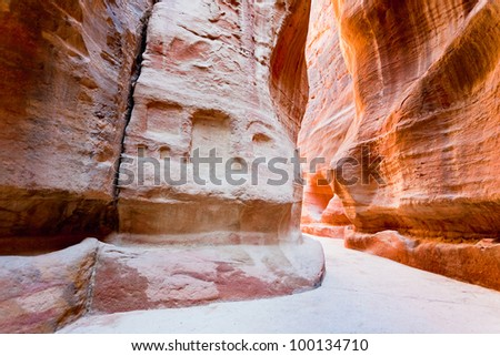 The Siq - narrow gorge to ancient city Petra, Jordan - stock photo
