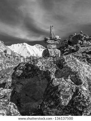 The sixth highest in the world peak the Cho Oyu (8153 m) and ritual pyramid - Gokyo region, Nepal, Himalayas (black and white) - stock photo