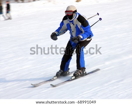 The skier quickly goes from mountain in winter equipment - stock photo