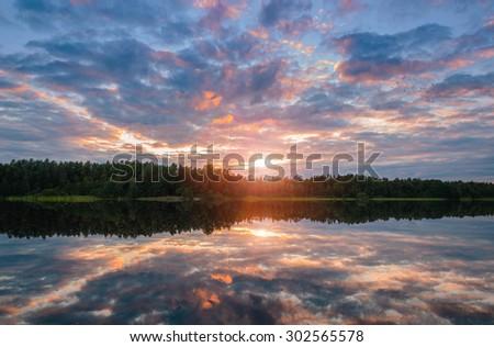 the sky beautiful sunset on the lake, Finland - stock photo