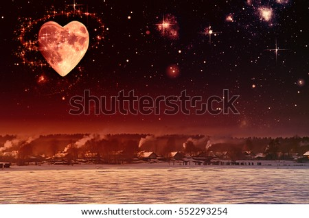 The sky is full of stars and the moon vvide hearts with milk way. Winter landscape with a village in the mountains.