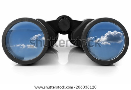 The sky reflected in a pair of new binoculars - stock photo