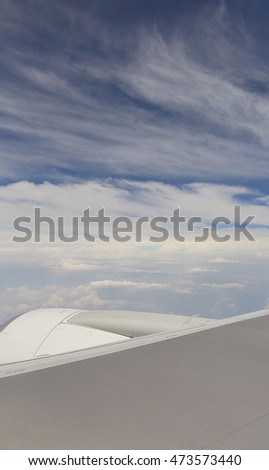 the sky when i am looking through window aircraft during flight in wing with a blue sky