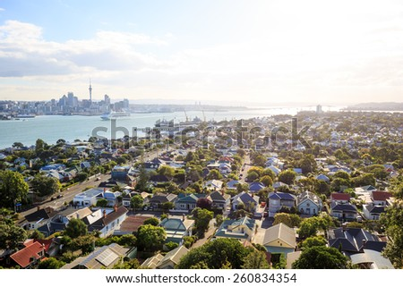 The skyline of Auckland seen from the village Devonport, New Zealand - stock photo