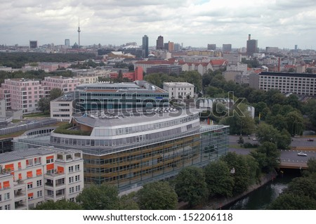 "the skyline of Berlin: in the foreground the ""Konrad Adenauer House"", the headquarters of the Christian Democrats, in the background with the high rise buildings at the Potsdamer Platz in Berlin. - stock photo"