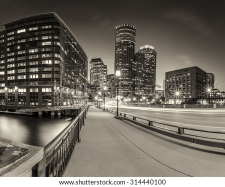 The skyline of Boston in Massachusetts, USA at night showcasing its mix of modern and historic architecture.