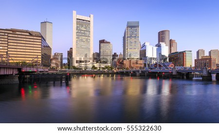 The skyline of Boston in Massachusetts, USA at sunrise showcasing its skyscrapers at the Financial District.