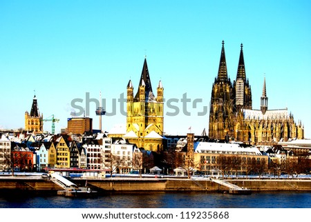 The skyline of Cologne in Germany with the Cathedral and the old town - stock photo