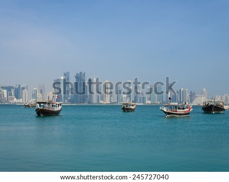 The skyline of Doha, Qatar, with a dhow in the foreground. - stock photo