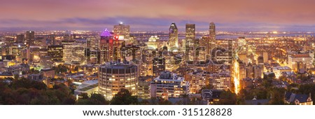 The skyline of downtown Montréal, Quebec, Canada from the top of Mount Royal. Photographed at dusk. - stock photo