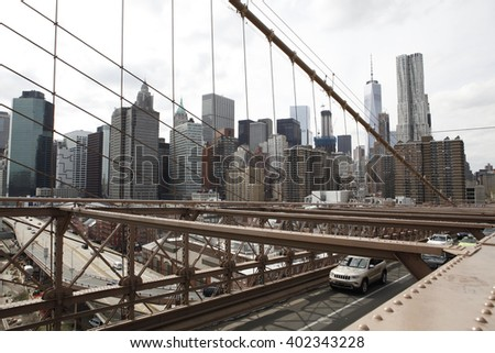 The skyline of Lower Manhattan as seen from the Brooklyn Bridge. The Brooklyn Bridge roadway is also visible.