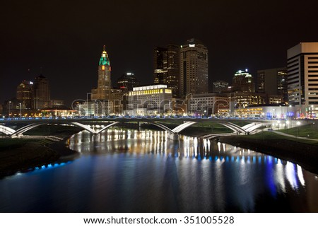 The skyline of the City of columbus, Ohio along the Scioto River after completion of the Scioto Greenway project. - stock photo